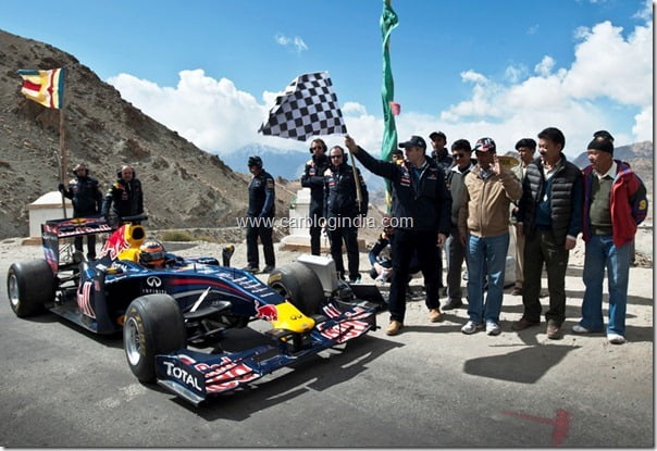 Omar Abdullah flags off the Red Bull Racing car driven by Neel Jani