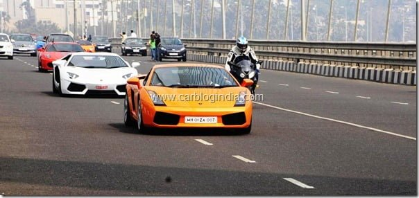 Gautam Singhania on the sea link in the lead car of the 4th Parx Super Car Show parade