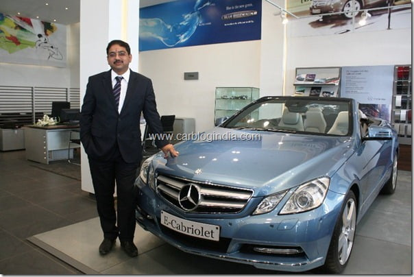Mr. Debashis Mitra, Director, Sales & Marketing, Mercedes-Benz India with the E-Cabriolet at the Benchmark Cars showroom in Indore