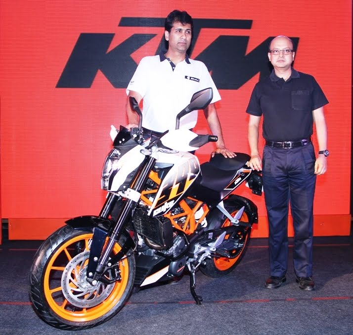 Mr. Rajiv Bajaj, MD, Bajaj Auto Ltd and Mr. Amit Nandi, VP, Probiking, Bajaj Auto Ltd. with the KTM Duke 390Mr. Rajiv Bajaj, MD, Bajaj Auto Ltd and Mr. Amit Nandi, VP, Probiking, Bajaj Auto Ltd. with the KTM Duke 390Mr. Rajiv Bajaj, MD, Bajaj Auto Ltd and Mr. Amit Nandi, VP, Probiking, Bajaj Auto Ltd. with the KTM Duke 390