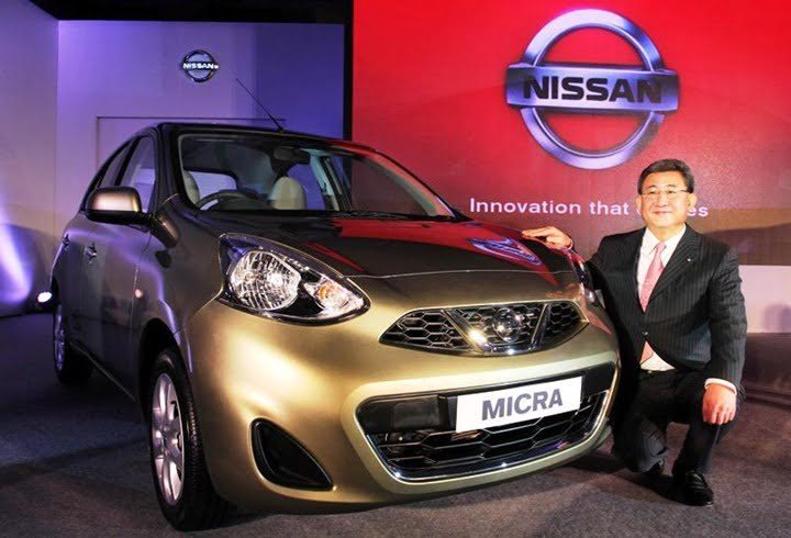 Kenichiro Yomura, President of Nissan India, poses with the new Nissan Micra, in Mumbai, India on July 3, 2013. The nation-wide sales for New Nissan Micra and Micra Active, built with Nissan's versatile 'V' platform, will commence with immediate effect.