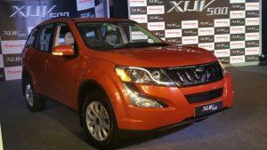 mahindra-xuv500-new-model-pics-front-angle-sunset-orange