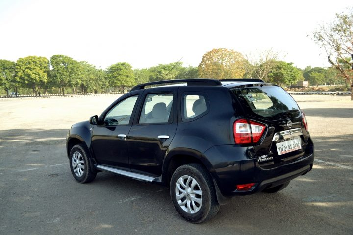 Nissan Terrano AMT Automatic Price, Specifications, Mileage Nissan-Terrano-Petrol-Review-Images-Black-Rear-Angle-Action