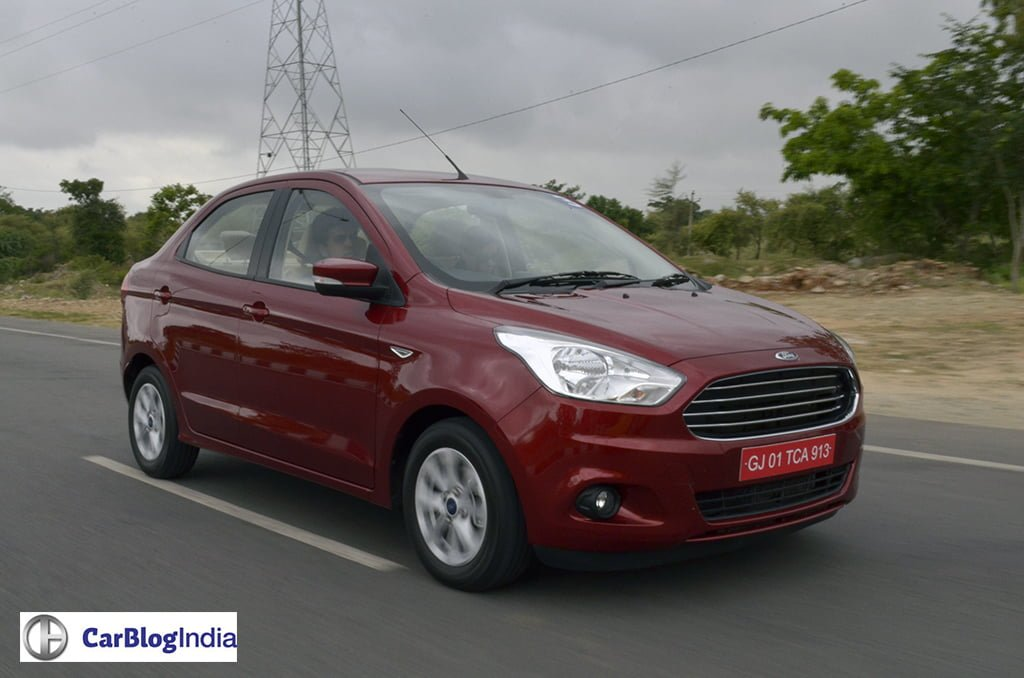 ford figo aspire review red front angle action