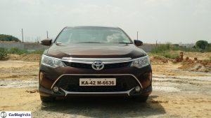 toyota camry price -2015-toyota-camry-hybrid-review-front-angle-front