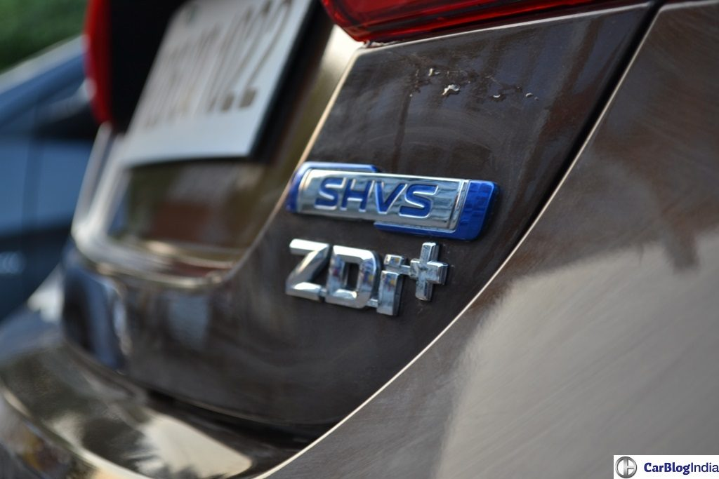 Diesel, Petrol Price in India - Delhi, Mumbai Diesel and Petrol Prices maruti-ciaz-SHVS-diesel-hybrid-review-pics-badge
