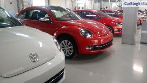 new-volkswagen-beetle-india- orange-white-side-angle
