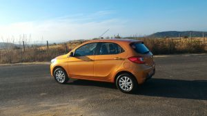 2016-tata-zica-orange-official-media-drive-images-side-angle-rear