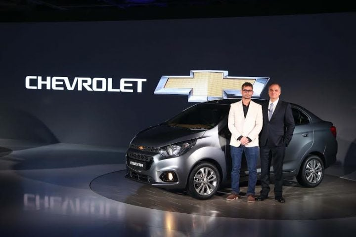 Chevrolet Essentia India Launch, Prices -Front-angle showing bumper, headlights, alloy wheels, doors,grille of Beat compact sedan