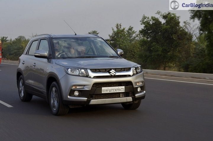 maruti vitara brezza review images front angle silver action