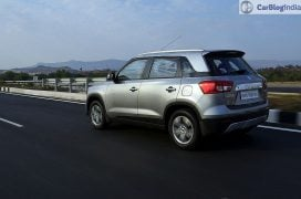 maruti vitara brezza review images side rear angle silver 1