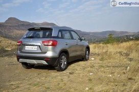 maruti vitara brezza review images rear angle silver 4