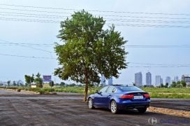 jaguar-xe-test-drive-review-rear-angle-far