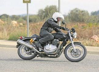 royal enfield 750cc bike images side profile action photo