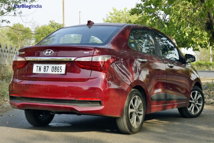 2017 hyundai xcent facelift test drive review rear angle
