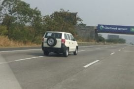 Mahindra TUV300 Plus images rear three quarters action