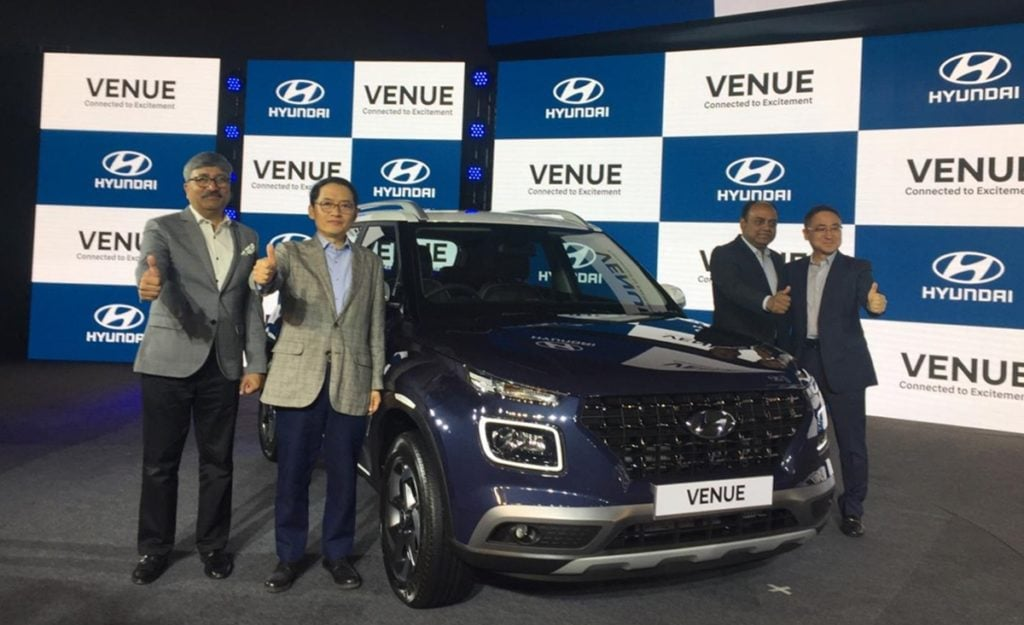 Hyundai Venue at its launch in Delhi along with officials from Hyundai