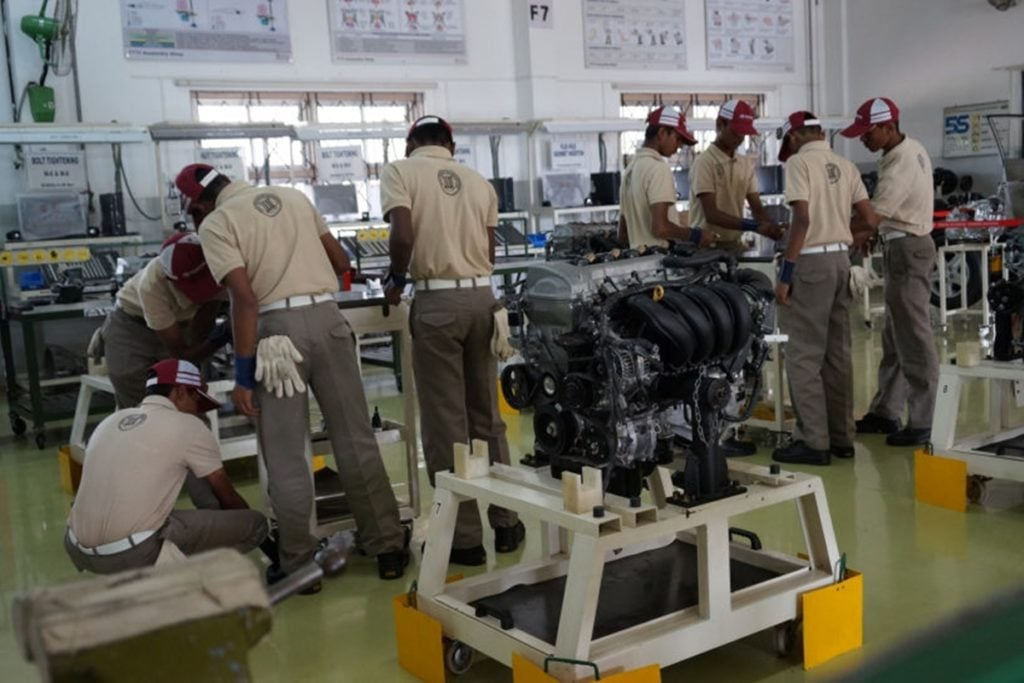 Students working on powertrains at Toyota Technical Training Institute (TTTI)