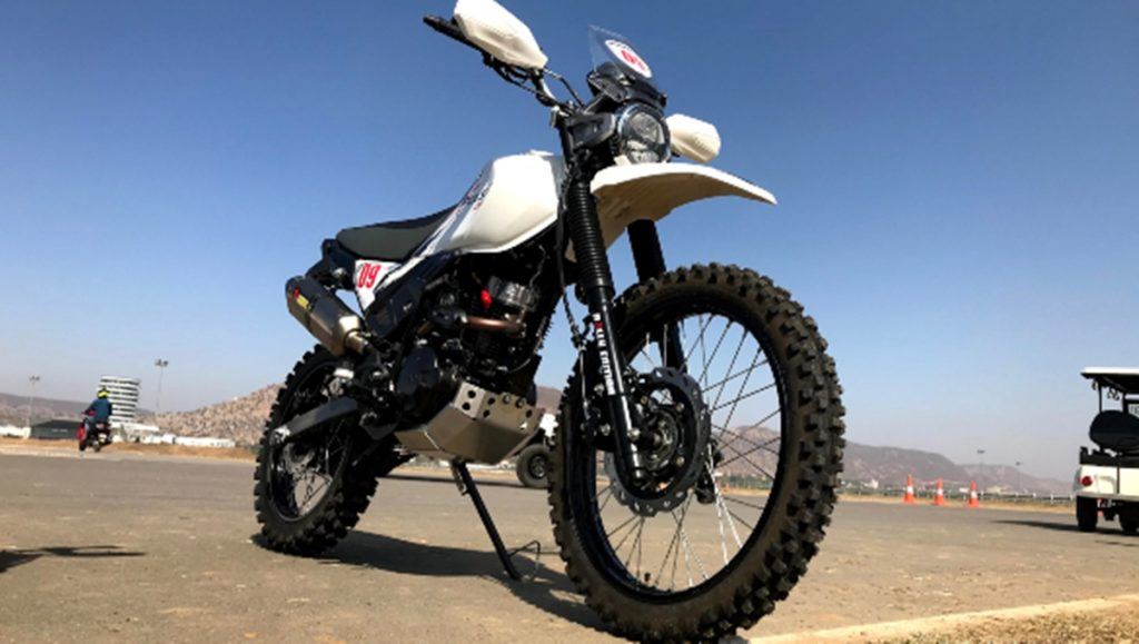 It gets long travel suspension, knobby tires and raised handle-bars