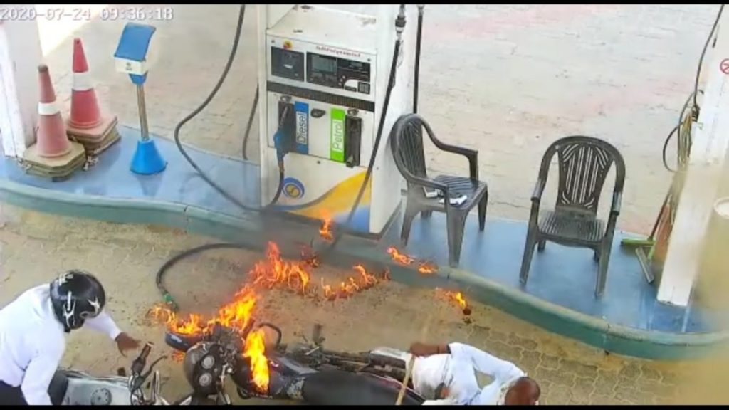 Motorcycle engulfed in flames as petrol pump staff is caught using phone.