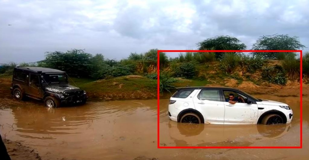 Watch a Mahindra Thar rescue a Land Rover Discovery Stuck in Mud.