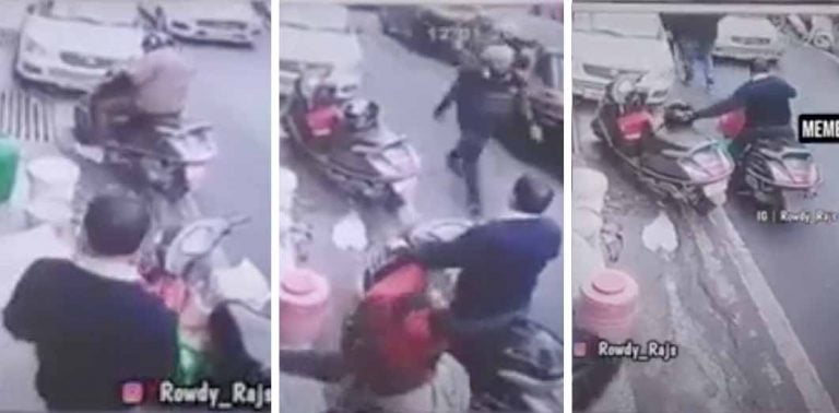 Watch a Honda Activa Rider Slyly Steal Another Active Rider's Helmet!